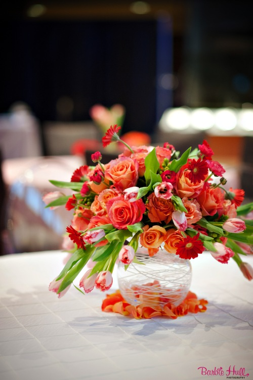 Christopher Flowers event floral musem wedding tulips roses ranunculus peach coral red orange green spring centerpiece