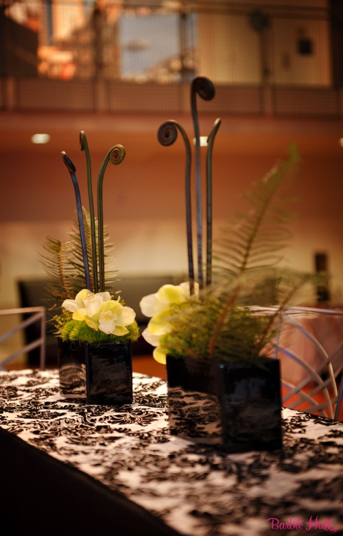 Christopher Flowers event floral museum green orchid fern moss centerpiece black white