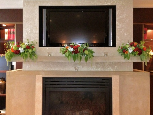 Christopher Flowers wedding red orange rose ranunculus green hydrangea orchid fireplace reception